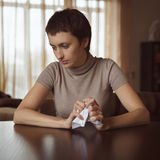 Sad girl holding a crumpled letter Royalty Free Stock Photography