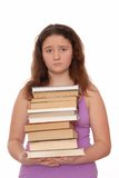 Sad girl holds  stack of books. Royalty Free Stock Image