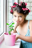 Sad Girl with houseplant in pink pot Royalty Free Stock Photography