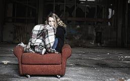 Sad Girl In Shabby Sofa Royalty Free Stock Photo