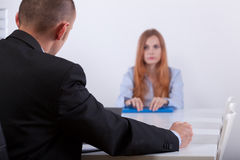 Sad girl listening to employer. On interview stock images