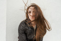 Sad girl with long hair in leather jacket Stock Photos
