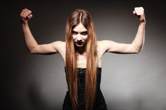 Sad girl with long hair showing her muscles Royalty Free Stock Photo