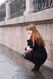 Sad girl with long red hair Stock Photography