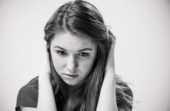 Sad girl looking down Stock Image