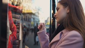 Sad girl looking in shop window, dreaming of expensive dress, sales and discount. Stock footage stock video footage