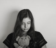 Sad Girl. Sad looking Girl with Teddy bear Royalty Free Stock Images