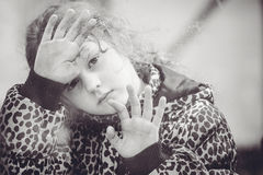 Sad girl looking from the window. Royalty Free Stock Photography