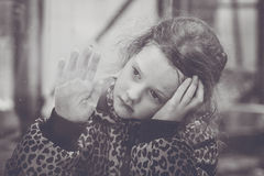 Sad girl looking from the window. Royalty Free Stock Images