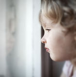 Sad girl looking at window Royalty Free Stock Photo