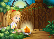 A sad girl making a campfire Stock Images
