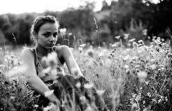 Sad girl in meadow royalty free stock image