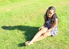Sad girl on meadow Stock Photography