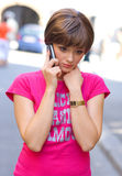 Sad girl with mobile phone Stock Photography