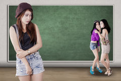 Sad girl mocked by her friends Stock Photo