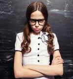 Sad Girl near blackboard Royalty Free Stock Photo