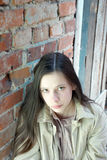 Sad girl near brick wall Royalty Free Stock Photo