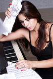 Sad girl near piano Royalty Free Stock Photography