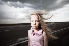 Sad girl near road Royalty Free Stock Photo