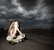 Sad girl near road. Child outdoors Royalty Free Stock Photography