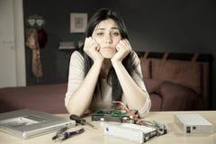 Sad girl not able to repair broken hard disk Stock Image