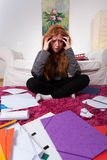 Sad girl among notes for exam Royalty Free Stock Photography