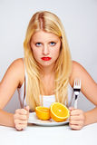 Sad girl with an orange Stock Images