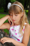 Sad girl in the park Royalty Free Stock Images