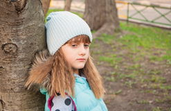 Sad girl in the park Stock Photo