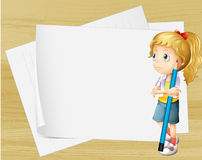 A sad girl with a pencil standing in front of the empty papers Royalty Free Stock Images