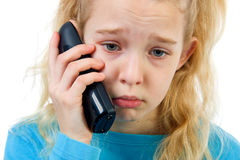Sad girl on the phone Royalty Free Stock Image