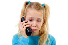 Sad girl on the phone Stock Images