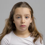 Sad girl. Portrait of a little girl making a sad expression Royalty Free Stock Photo