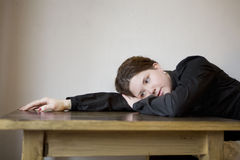 Sad girl put her head down table Stock Images
