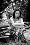 Sad girl on railway Stock Images