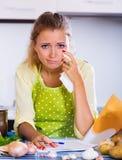 Sad girl reading banking statement Royalty Free Stock Images