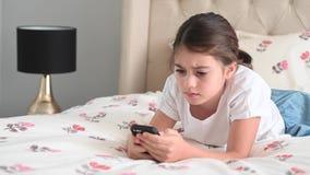 Sad girl reading a bullying post on social media