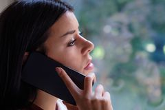 Sad desperate woman making a phone call stock image