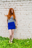 Sad girl with red hair Royalty Free Stock Images
