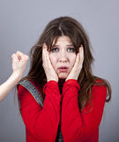 Sad girl in red and hand fist. Stock Photography