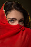 Sad girl in red hijab Royalty Free Stock Photography
