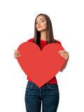 Sad girl in red shirt with big red heart Stock Images