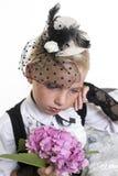 Sad girl in retro style clothing Stock Image