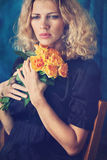 sad girl with a roses. Stock Image