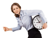 Sad girl runs with a clock Stock Images