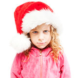 Sad girl in santa hat Royalty Free Stock Images