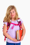 Sad girl with schoolbag. On first day at school Royalty Free Stock Photography