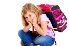 Sad girl with schoolbag. In front of white background Stock Photography