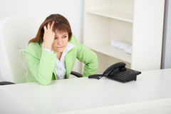 Sad girl secretary waits for phone call. The sad girl the secretary waits for phone call royalty free stock images
