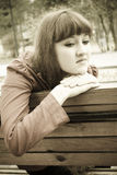 Sad girl in sepia tones Royalty Free Stock Photo
